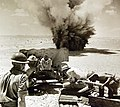 Enemy shell landing close to 6-pound gun, North African Campaign, WWII (36845603260).jpg