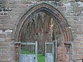 Entrance to Sweetheart Abbey showing part of interior - geograph.org.uk - 663170.jpg