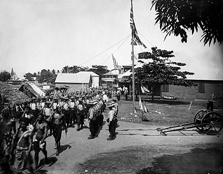 The joint commission of Germany, the United States and Great Britain abolished the Samoan kingship in June 1899 Escorting Tanumafili I.jpg