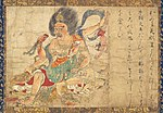 A deity embellished with ornaments and four arms grabbing three much smaller persons in three of his hands and the lower body part of another in his fourth hand. To the right of the scene there is Japanese calligraphic text.