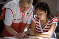 FEMA - 29748 - Red Cross volunteer and shelteree in NJ, photography by Andrea Booher.jpg