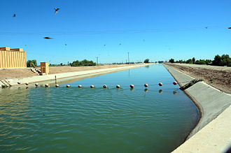 All-American Canal - A section of the canal, showing the steep concrete liner and a line of buoys added to prevent drowning