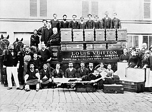 Louis Vuitton (designer) - In the courtyard of the Asnières workshops, around 1888, Louis, Georges and Gaston L. Vuitton (sitting on a bed trunk)