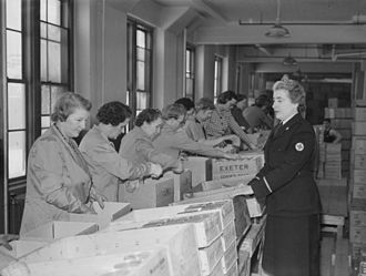 Canadian Red Cross - Volunteers from Canadian Red Cross assemble packages for prisoners of war during the Second World War.
