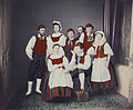 Finnish traditional costumes, Zacharias Topelius in the background.jpg