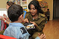 Flickr - Israel Defense Forces - Soldiers Celebrate Purim with At-Risk Children (7).jpg