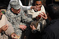 Flickr - The U.S. Army - Gen. David Petraeus breaks bread with villagers.jpg