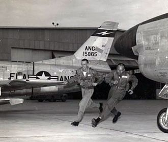 159th Fighter Squadron - U.S. Air Force pilots 1st Lt Wally Green and Capt Dick Locker of the 159th Fighter Interceptor Squadron, 125th Fighter Interceptor Wing, Florida Air National Guard, race to their North American F-86D-25-NA Sabre fighters during an alert scramble at Jacksonville, Florida (USA), in the late 1950s