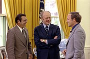 White House Chief of Staff Cheney (right) and Secretary of Defense Donald Rumsfeld (left) meet with President Ford at the White House, April 1975.