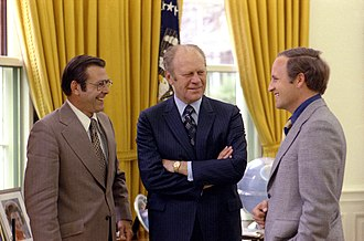 Dick Cheney - White House Chief of Staff Donald Rumsfeld (left) and his assistant Cheney (right) meet with President Gerald Ford at the White House, April 1975