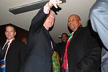 Former Pres. Bill Clinton Speaks With South African Minister of Justice Radebe.jpg