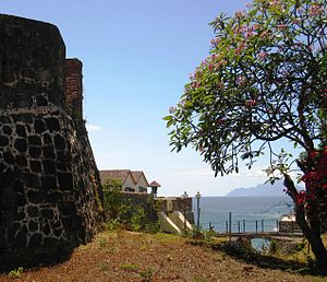 Sint Eustatius - 17th-century Fort Oranje, with the island of Saba visible in the distance.