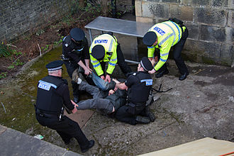 2011 Hetherington House Occupation - Two men are removed by police officers from the back door area of Hetherington House during the eviction on 22 March 2011