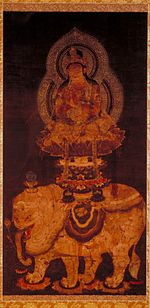 Side view of a deity seated on a pedestal on top of a white elephant.