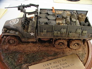 Model military vehicle - 1:35 scale GMC truck model with a landscaped base.
