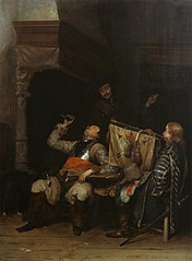 Soldiers drinking, smoking and playing music in an interior