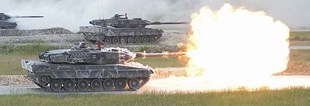 German Leopard 2A6 from a Panzerbattalion fires its main gun during the shoot-off of Strong Europe Tank Challenge. German Leopard 2A6 from 3rd Panzer Battalion fires it's main gun during the shoot-off of Strong Europe Tank Challenge (40964003420) (cropped).jpg