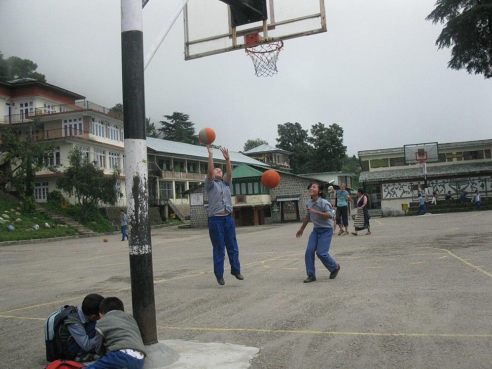 Girls play basketball in Dharmsala, India
