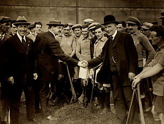 James Nowlan - James Nowlan (right - dark suit with bowler style hat) shakes hands with Michael Collins (left) ahead of the 1921 Leinster hurling final
