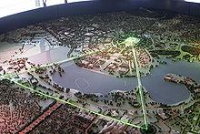 En lille model lavet af enten ler eller plast.  Grønne lasere bruges til at afgrænse trekanten.