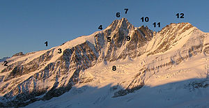 Grossglockner - The Grossglockner from the northeast: 1. Adlersruhe, 2. Hofmannskees, 3. Kleinglocknerkees, 4. Glocknerleitl, 5. Pallavicinirinne, 6. Kleinglockner, 7. Grossglockner, 8. Glocknerkees, 9. Berglerrinne, 10. Glocknerhorn (left) and Teufelshorn (right), 11. Untere Glocknerscharte, 12. Glocknerwand