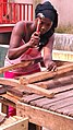 Guinean Woman Works Construction Two.jpg