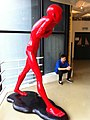 HKAC Wan Chai 香港藝術中心 Hong Kong Arts Centre 陳文令 Chen WenLing red sculpture long figure n visitor July-2013.JPG