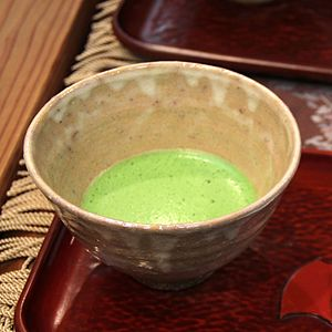 Hagi ware - Hagi ware chawan with macha green tea, by Yū Okada (2011)
