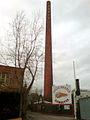 Hannover Badenstedter Straße 46 a b c d Hells Angels Place Hinweisschild Orpil Seifenwerke Chemie Schornstein links Halle der Lindener Eisen- und Stahlwerke.jpg