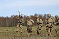 Headquarters Troop, 3rd Squadron, 2nd Cavalry Regiment, pull a rope attached to a Latvian Mi-17 helicopter.jpg
