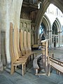 High-backed chairs, top of the nave, Wells Cathedral.jpg