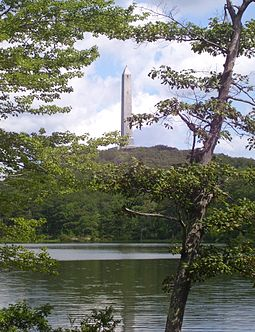 High Point Monument as seen from Lake Marcia at High Point, Sussex County, the highest elevation in New Jersey, at 1803 feet above sea level. High Point Monument and Lake Marcia framed.jpg
