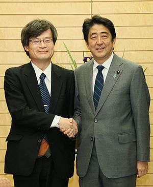 Hiroshi Amano - with Shinzō Abe (at the Prime Minister's Official Residence on October 22, 2014)