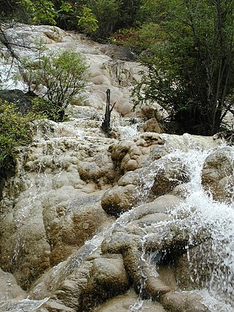 Min Mountains - A waterfall at the Huanglong site