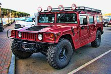 a-modified-red-hummer-h1-in-a-parking-lot