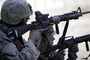 Red dot sight - A U.S. Marine looking through an ITL MARS combination red dot and laser sight mounted on his M16A4 MWS rifle during the Second Battle of Fallujah in 2004.