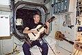 ISS-55 Drew Feustel plays guitar inside the Unity module.jpg
