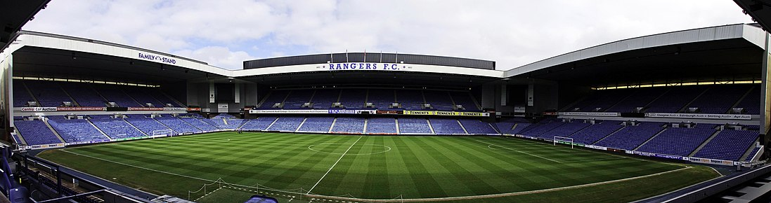 A panorama of Ibrox Stadium taken from the Bill Struth Main Stand, showing from left to right the Broomloan Road Stand, the Sandy Jardine Stand and the Copland Road Stand