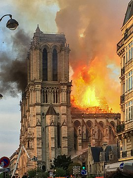 The 2019 fire destroyed the roof and spire but left the structure intact Incendie Notre Dame de Paris.jpg