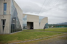 Photograph of a modernistic building.