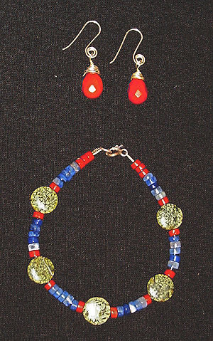 Serpentine subgroup - Necklace and earring set made from semiprecious stones.  The spherical green beads are Russian serpentine.  Also used are jasper (red) and fluorite (blue).