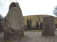 "The Jelling Stones, Denmark's ""birth certificate"", seen from the north with ""Gorm's Mound"" in the background."