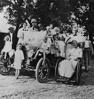 Samuel Ealy Johnson Jr. -  A Johnson Family gathering in 1912. The third adult from left in the back row is Sam Ealy Johnson Jr. His wife, Rebekah Baines Johnson is in front of him. Sam Ealy Johnson Jr.'s mother, Eliza Bunton Johnson is seated in the wheelchair. Lyndon B. Johnson (ca. 4 years old) is standing in front of the automobile.