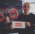 Joshua Oppenheimer with Cinema of Change press card.png