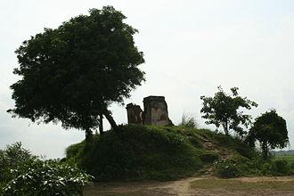 Kampil - Ruins of an ancient temple in Kampil (Kampilya). The mound below indicates an archaeological site