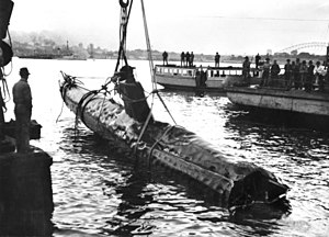 Port Jackson - A Japanese Kō-hyōteki class midget submarine M-21 being raised from Taylor's Bay on 1 June 1942