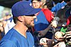 Kris Bryant signing autographs during his rehab assignment against Omaha (30447711458).jpg
