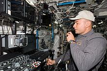 Lee Archambault at the Canada Arm 2 controls on ISS