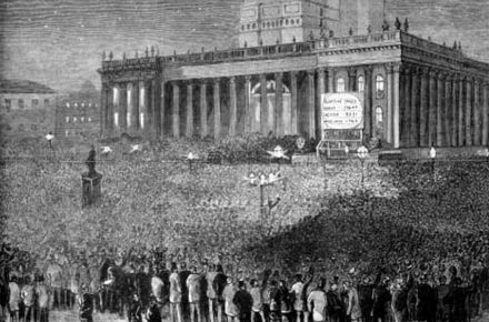 A crowd gathers outside Leeds Town Hall during the 1880 general elections. Leeds Town Hall, General Election results.jpg