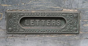 New Orleans: Brass letter slot in old door, Al...